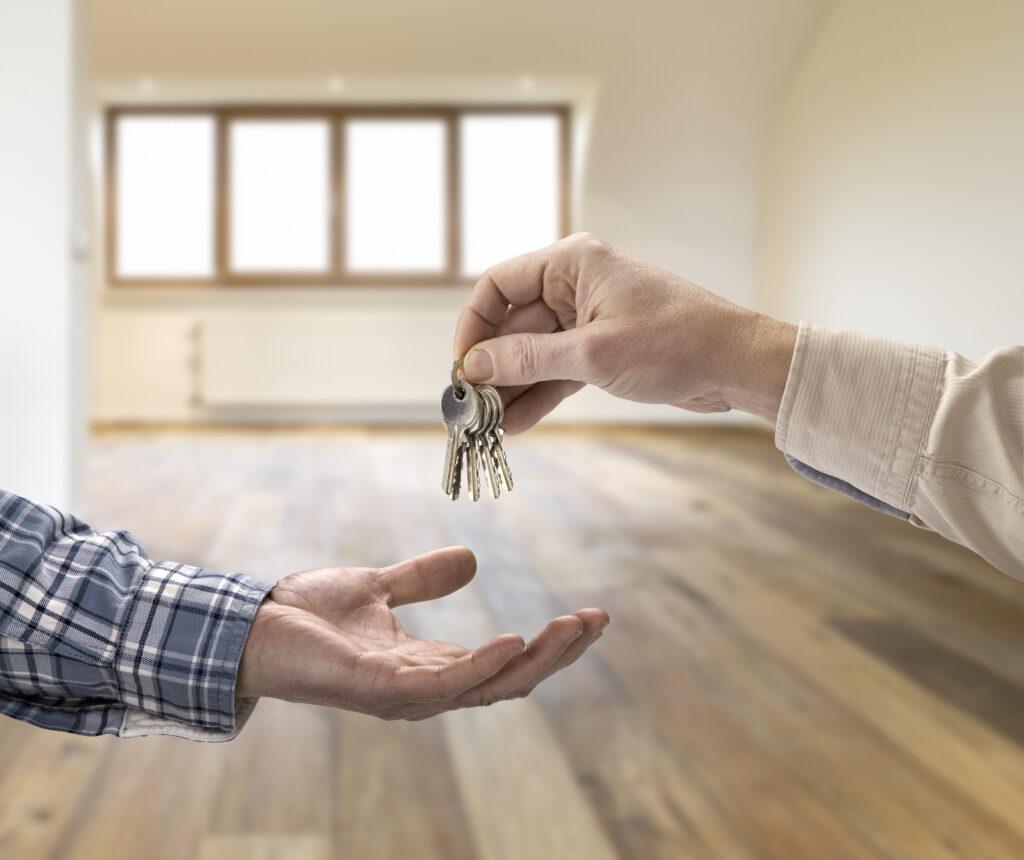 realtor giving house keys to tenant
